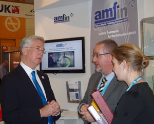 Business minister Michael Fallon meets Mike Beirns Amfin MAA stand Paris 2013